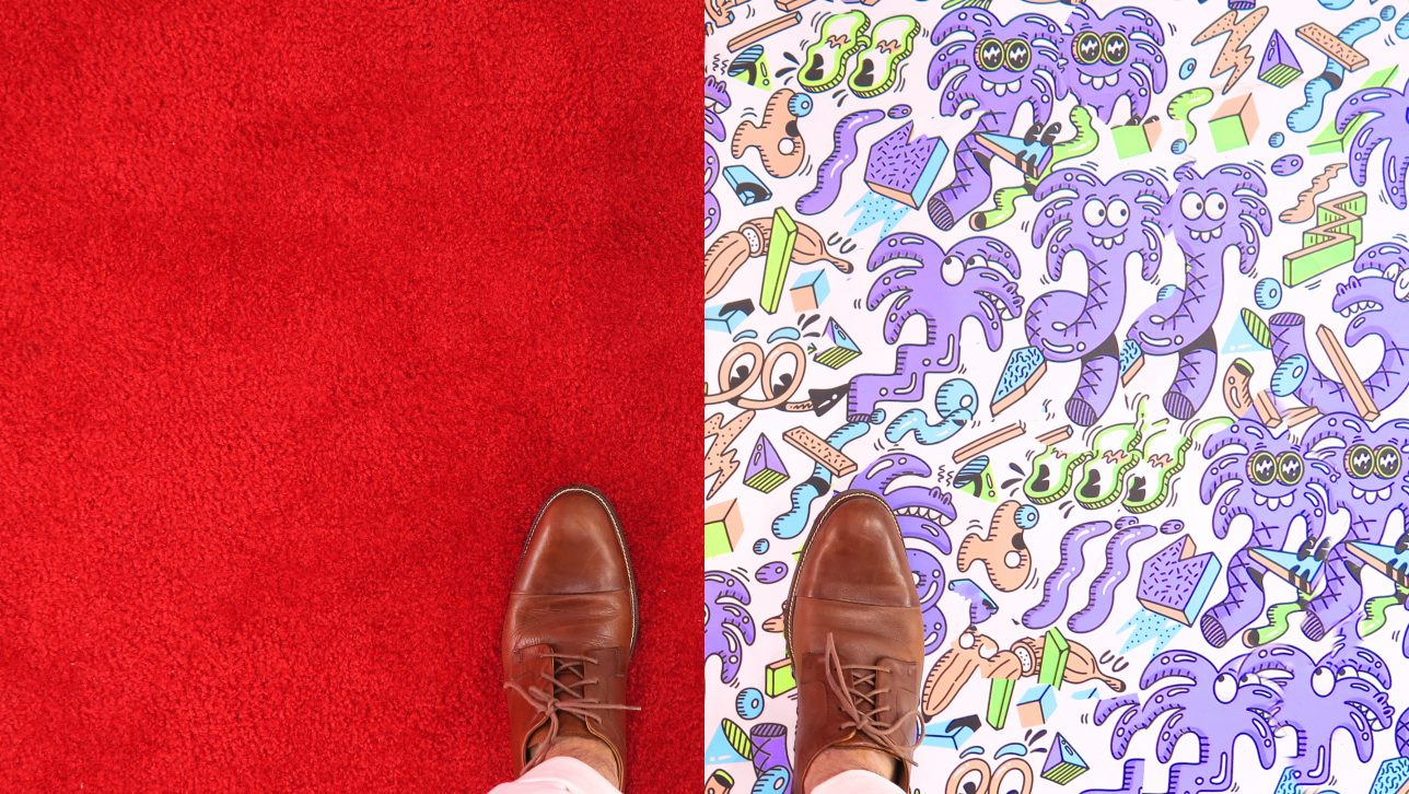work shows on red and purple carpet; photo by Joshua Coleman via Unsplash