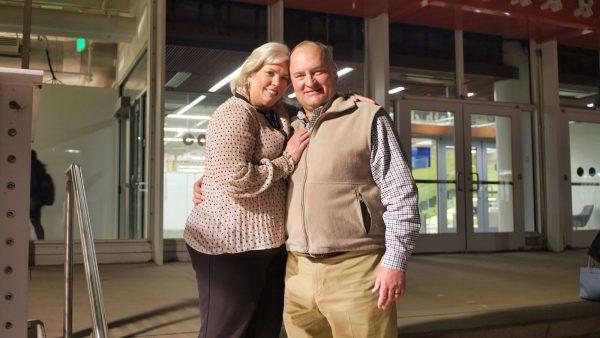 Bob and Lisa Abyeta stand on the steps of the Auraria Library, where they first met.