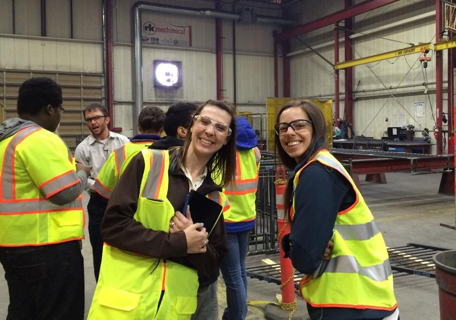 two women inside factory