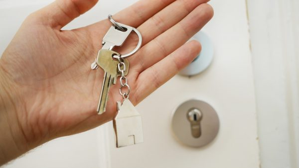 Person holding a set of keys