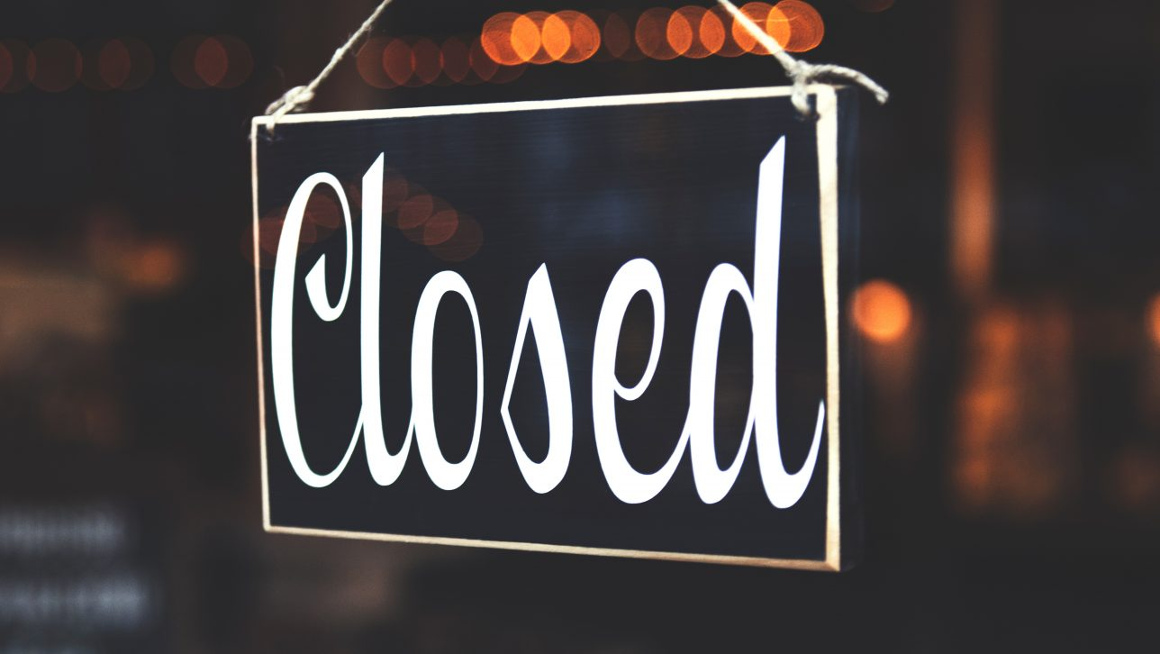 closed sign in shop window; photo by  Tim Mossholder via Unsplash