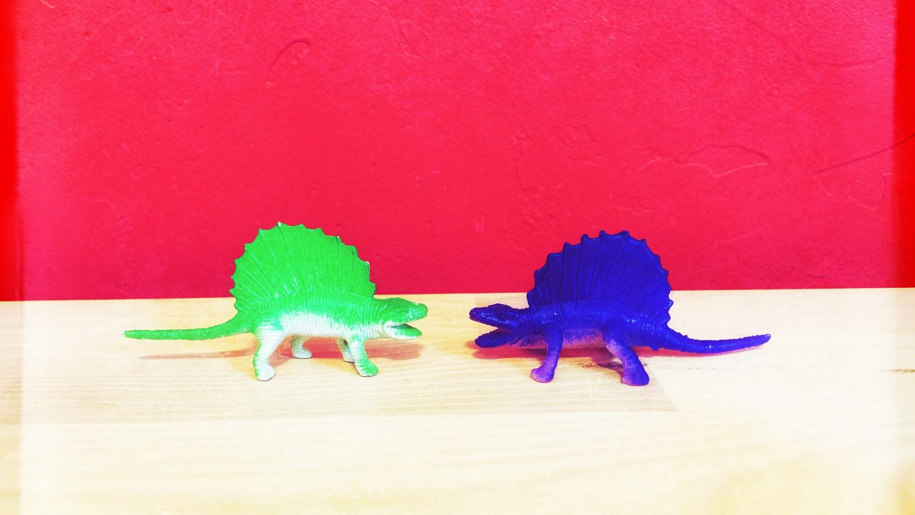 toy dinosaurs looking at each other