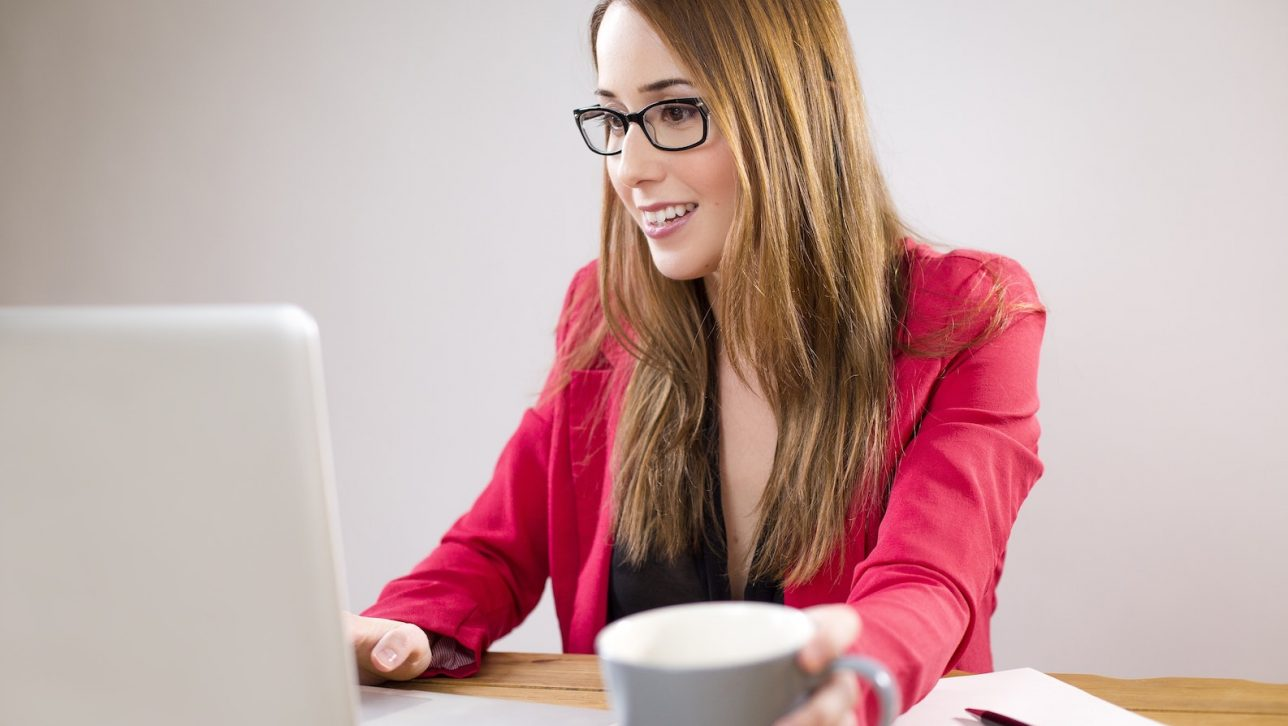 Women wearing glasses on a computer