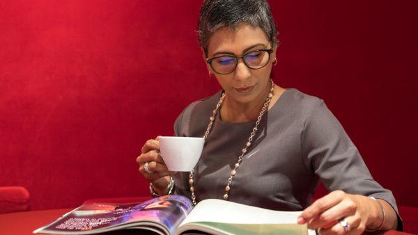woman reading; photo by bbh Singapore via unsplash