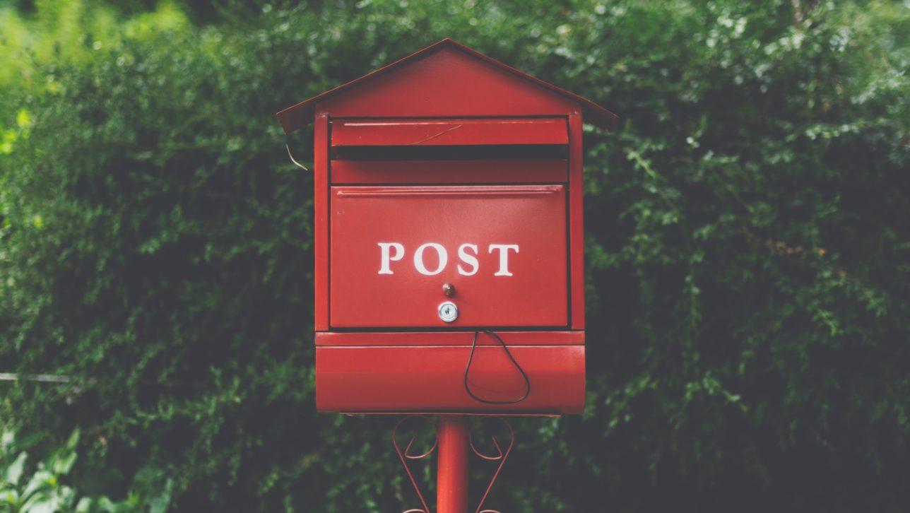 red mailbox by undo Kim via unsplash