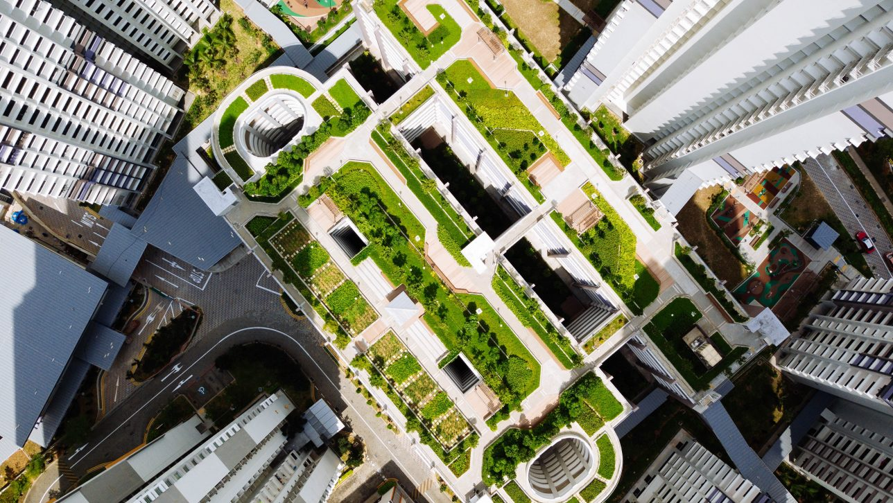 green roof in downtown city seen from above; photo by chuttersnap via unsplash
