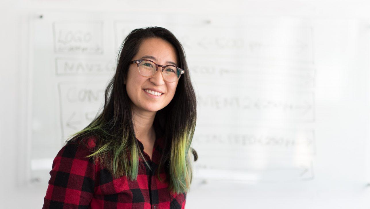 female teacher in front of whiteboard