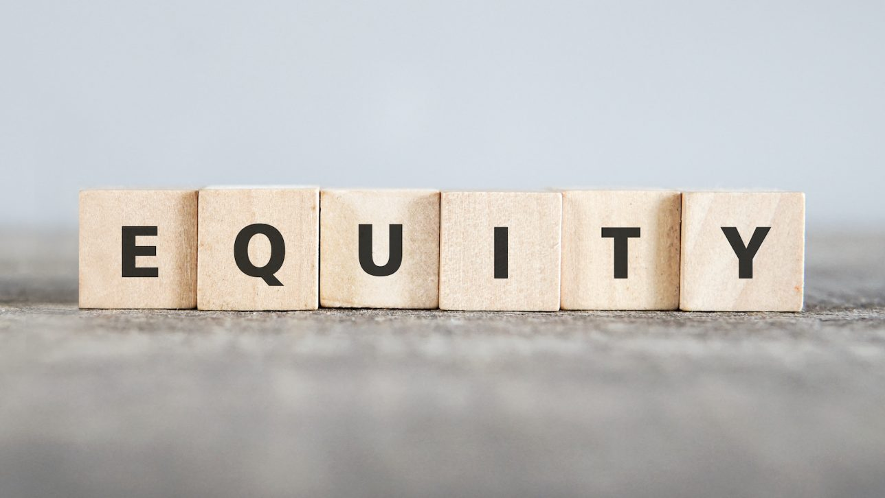 Equity, spelled out with scrabble tiles