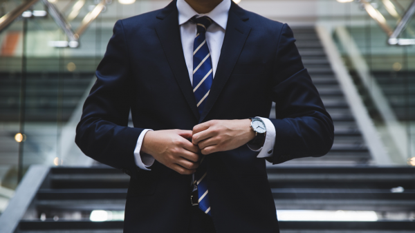 man in suit; photo via unsplash
