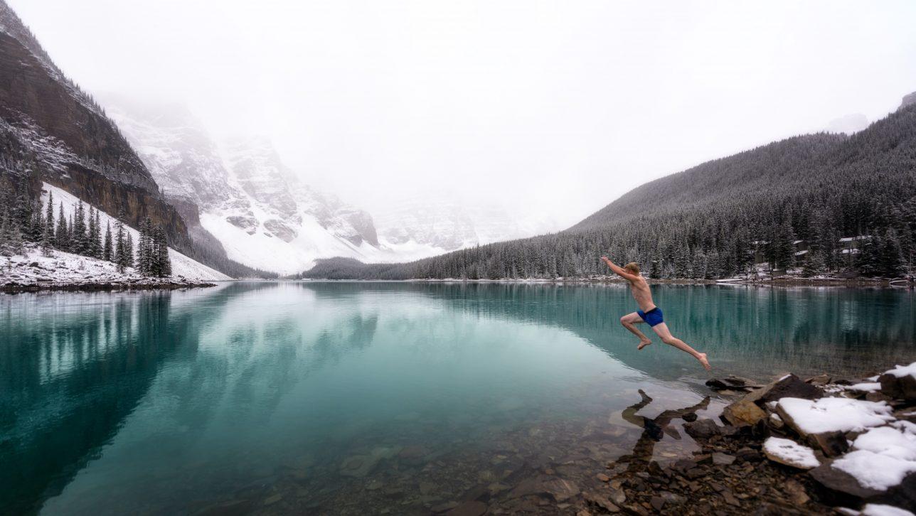 man jumping into alpine lake; photo by Tyler Lillico via unsplash