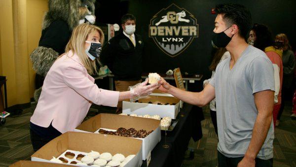 Chancellor Marks handing out a cupcake