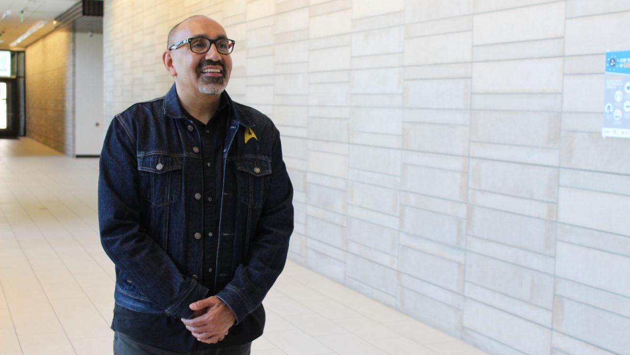Manuel Espinoza standing in hallway