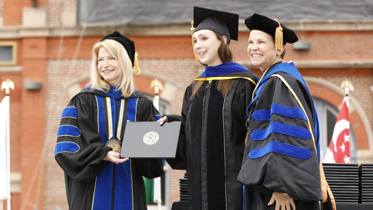 Chancellor Marks handing out diploma