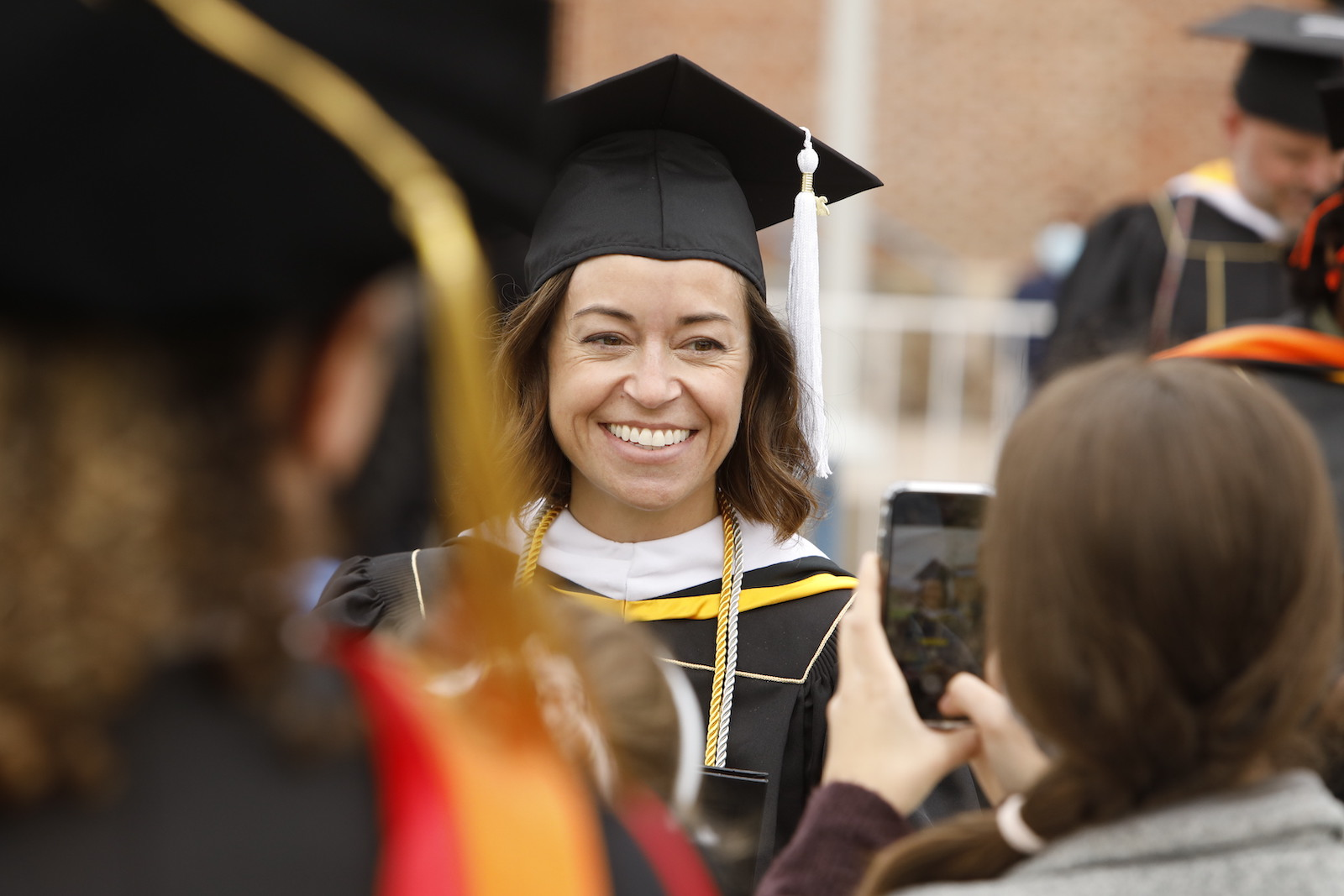 Graduate smiling for photo