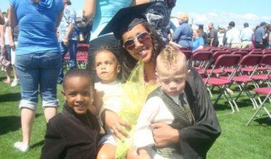 Danielle Shoots holding her children