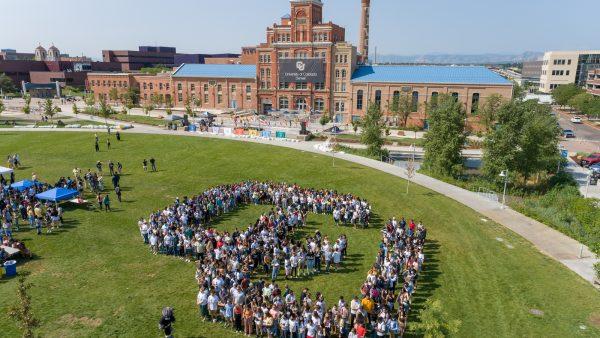 Students forming CU-Denver logo