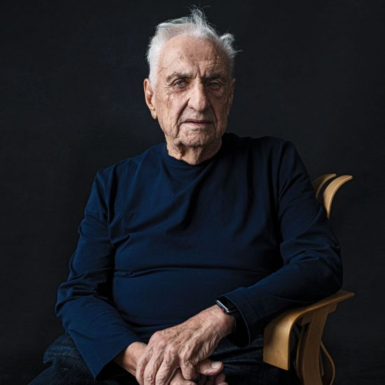 Frank Gehry sitting on a chair