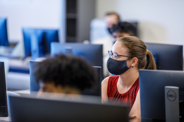 Students listening to lecture in computer lab