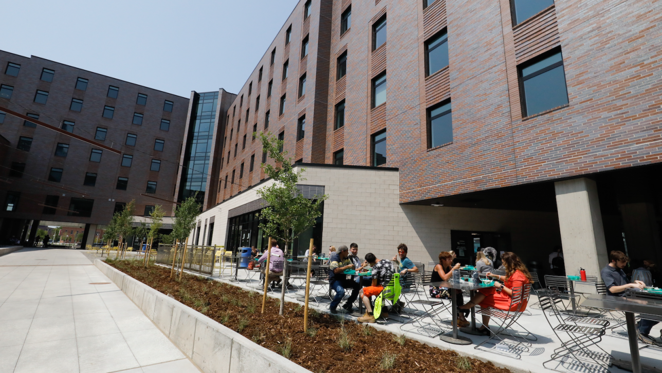 People sitting in patio outside of building