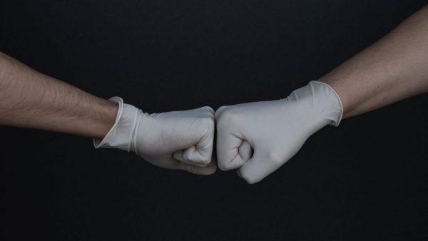 latex glove fist bump